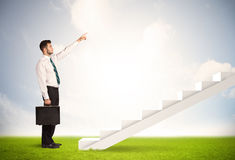 Business person climbing up on white staircase in nature Stock Image