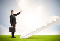 Business person climbing up on white staircase in nature Royalty Free Stock Photography