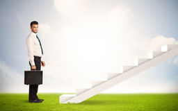 Business person climbing up on white staircase in nature Stock Photography