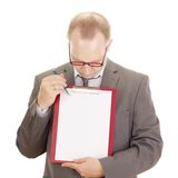 Business person with clipboard. A business person with a clipboard Royalty Free Stock Photography
