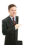 Business Person Design Element. Businessman pointing at blank white space.  Design elemant isolated Royalty Free Stock Image