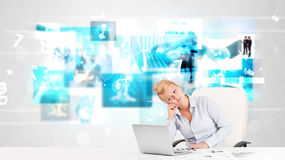 Business person at desk with modern tech images at background Royalty Free Stock Photo