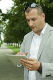 Business Person with a Digital Tablet in the Nature Stock Photo