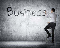 Business person drawing business on the board Stock Photography