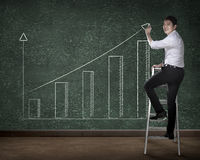 Business person drawing chart on the board Royalty Free Stock Photo