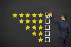 Business Person Drawing Customer Satisfaction on Blackboard Stock Photography