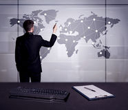 Business person drawing dots on world map. A young office worker drawing on world map and connecting dots with lines, presenting marketing sterategy at office Stock Photography