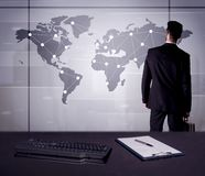 Business person drawing dots on world map. A young office worker drawing on world map and connecting dots with lines, presenting marketing sterategy at office Stock Photo