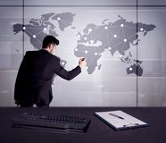 Business person drawing dots on world map. A young office worker drawing on world map and connecting dots with lines, presenting marketing sterategy at office Stock Photos