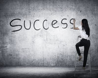 Business person drawing success on the board Stock Photo
