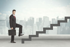 Business person in front of a staircase Royalty Free Stock Photography