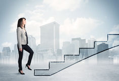 Business person in front of a staircase Stock Images