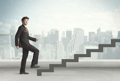 Business person in front of a staircase Stock Photography