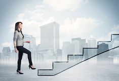 Business person in front of a staircase Stock Photos