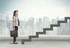Business person in front of a staircase. City on the background Stock Image