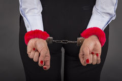 Business person handcuffed behind back Royalty Free Stock Image