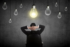 Business person having bright idea Stock Photography
