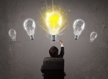 Business person having an idea light bulb concept Stock Image