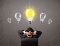 Business person having an idea light bulb concept Royalty Free Stock Photos