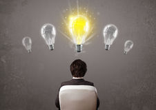 Business person having an idea light bulb concept Royalty Free Stock Images