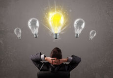 Business person having an idea light bulb concept Royalty Free Stock Image