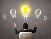 Business person having an idea light bulb concept Stock Photos