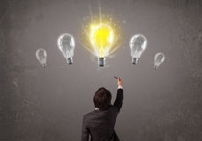 Business person having an idea light bulb concept Stock Photography