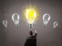 Business person having an idea light bulb concept Royalty Free Stock Photos