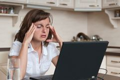 Business person with headache in work Royalty Free Stock Photo