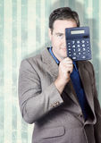 Business person hiding behind cash calculator Royalty Free Stock Image