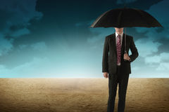 Business Person Hold Umbrella On Desert. Business person holding umbrella standing on the desert Royalty Free Stock Photos