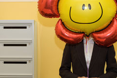 Business person holding balloon, midsection Stock Images