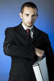 Business person holding a briefcase royalty free stock photos