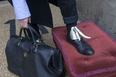 Business person holding a briefcase Stock Images