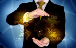 Business person holding earth statistics map Stock Photography