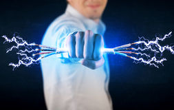 Business person holding electrical powered wires Stock Image