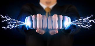 Business person holding electrical powered wires Stock Images