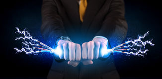 Business person holding electrical powered wires Royalty Free Stock Photos