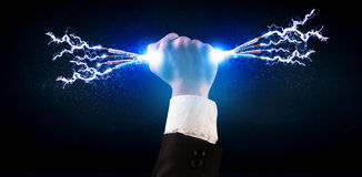Business person holding electrical powered wires Royalty Free Stock Image