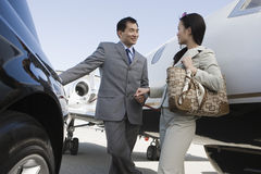 Business Person Holding Hands At Airfield Stock Photos