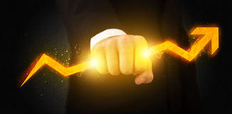 Business person holding a hot glowing upright arrow Stock Photos