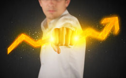 Business person holding a hot glowing upright arrow Stock Photography