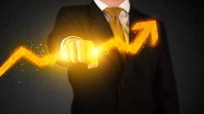 Business person holding a hot glowing upright arrow Royalty Free Stock Images