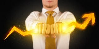 Business person holding a hot glowing upright arrow Stock Images