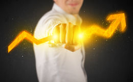 Business person holding a hot glowing upright arrow Stock Image