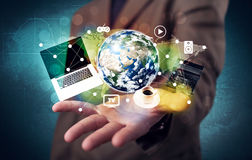 Business person holding laptop and globe Stock Image