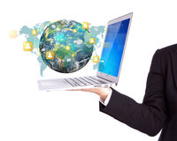 Business person holding Laptop with social network on earth Royalty Free Stock Images