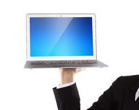 Business person holding an open laptop Stock Photos