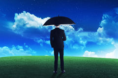 Business person holding umbrella Stock Photography