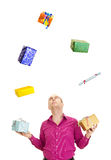 Business person juggling with some gifts. A business person juggling with some colorful gifts Stock Photo